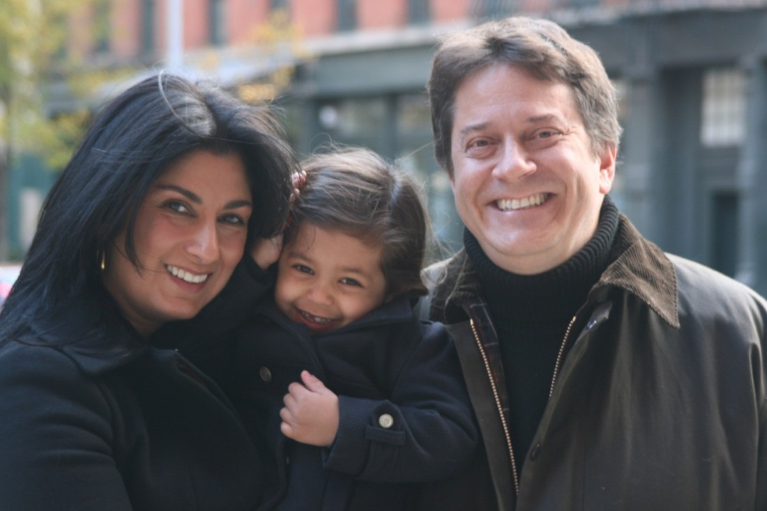 Barbara Sinclair Gallery portrait featuring a family of three smiling on a NYC street.
