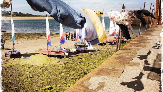 Clothes drying and sails flapping in the wind on the beach in North Berwick, Scotland. Photo by Barbara Sinclair
