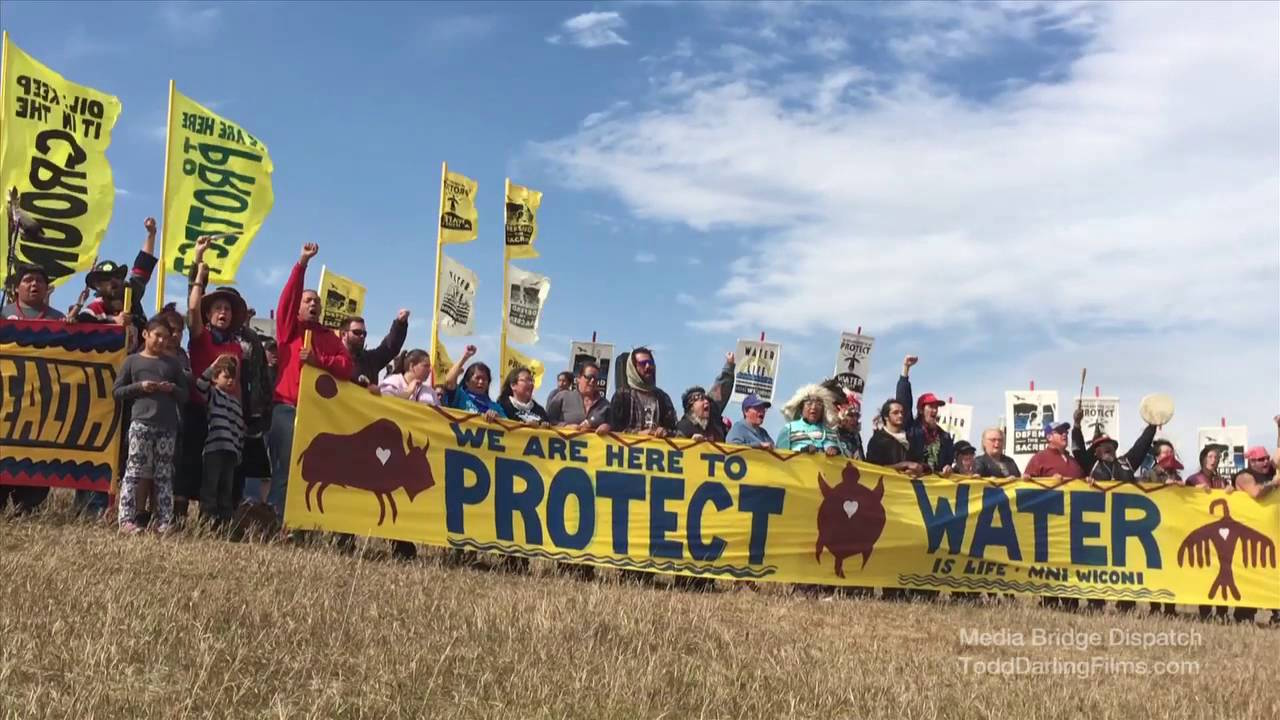 Standing Rock demonstration against the Dakota Access Pipeline. Image by Media Bridge Dispatch, ToddDarlingFilms.com, Barbara Sinclair Holistic Health, Native American Rights